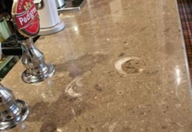 Mandale Fossil made into a bar top by Natural Stone Sales.