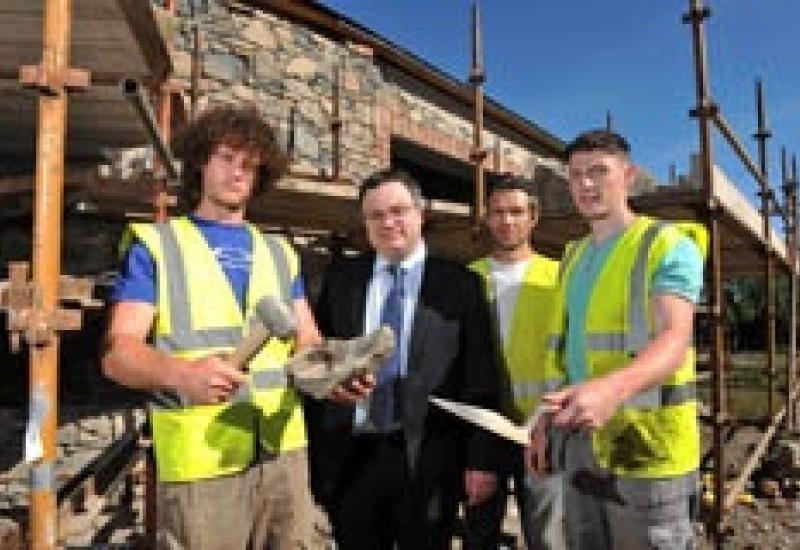 Pictured (left to right) at the Cultra building site are: Michael Brannigan, Dr Stephen Farry, Fergus Rooney (owner of Art of Stone) and Mark Lappin,