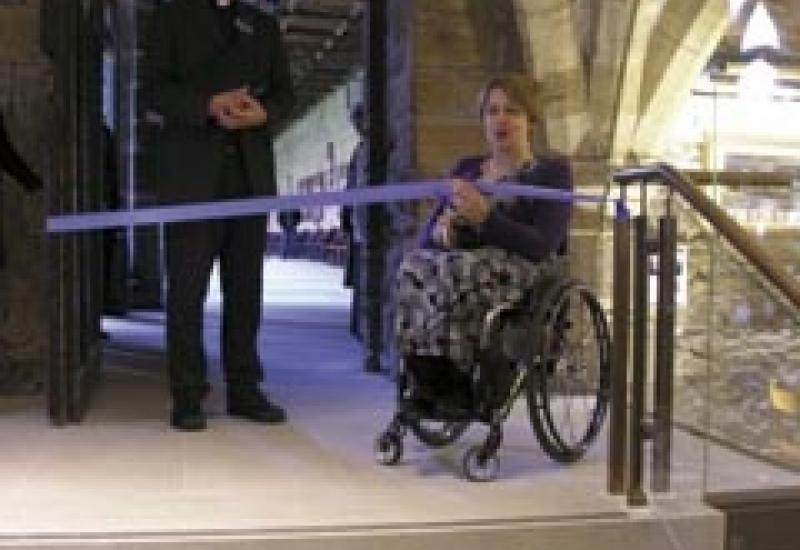Baroness Thompson cuts the ribbon to open the new shop at Durham Cathedral, accompanied by The Very Reverend Michael Sadgrove, Dean of Durham.