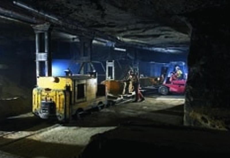 Inside Chilmark mine with the train being loaded with newly extracted block.