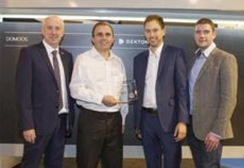 Christophe Gontier (second left) of Cosentino UK and Ireland receives the Innovation Award at KBB in March.