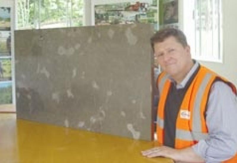 Vince Tourle, in charge of Gallagher's masonry operations, with a slab of polished Kentish Ragstone, ideal for flooring.