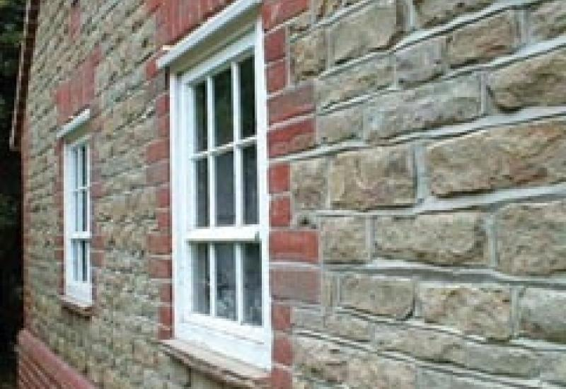 Horsham stone used in conjunction with brick on a house in Sussex.