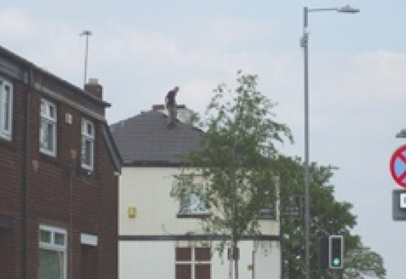 Caught in the act: On the roof of the Black Horse without a harness.