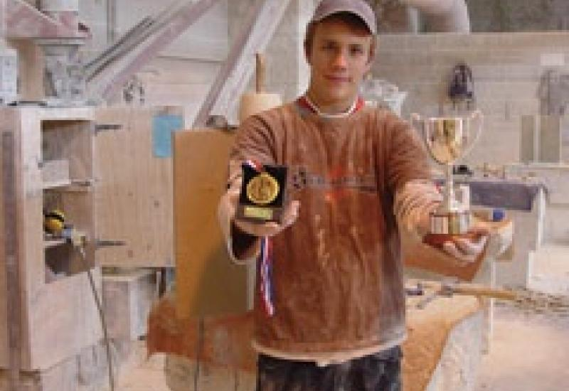 Top student Nathan Smith with some of his trophies