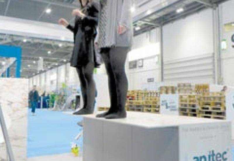 12mm Lapitec with a 350mm unsupported overhang carrying 120kg – an impressive demonstration at EcoBuild.