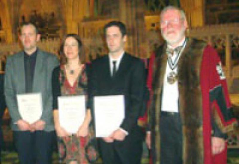 (L-R) Owen Whitfield, Anna Steinmetzer and Matt Hoskins receive their Duke of Gloucester Awards from Bill Gloyn, Master of the Masons' Livery Company.