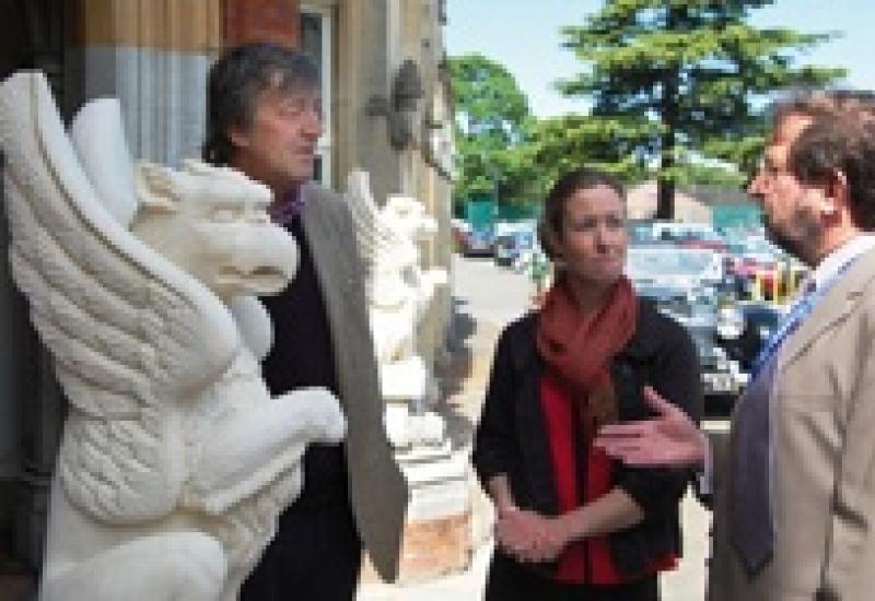 Stephen Fry with Michelle Brown, a stone carver with Rattee & Kett, and Simon Greenish, CEO of Bletchley Park Trust.