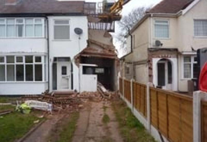 The partially collapsed house after the foundations for an extension next door had been dug.
