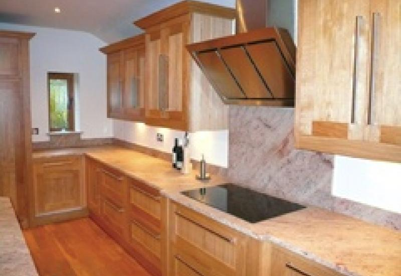Worktops in Beige Olympio leathered Silestone from Cosentina, worked and installed by Russell Stone Fixing for Armstrong Jordan.