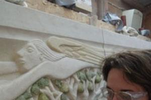 Antonia Hockton working on the reredos in her workshop and the finished work in the church.