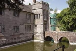 The red look at Baddesley Clinton is caused by algae, not a red stone.