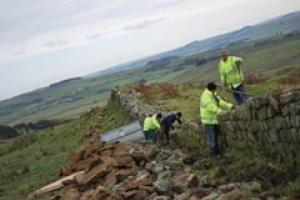 A dry stone wall that protects Hadrian's Wall being rebuilt.