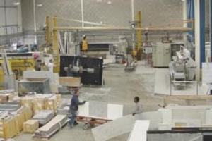 A busy workshop can still be a safe workshop with the right handling equipment and the right attitude. This is the workshop of Mega Marble in London.