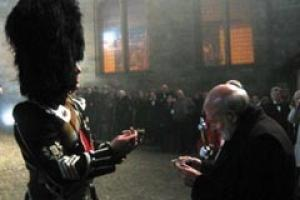Harry Turnbull accepts the salute from the Pipe Major on a misty night at Stirling Castle.