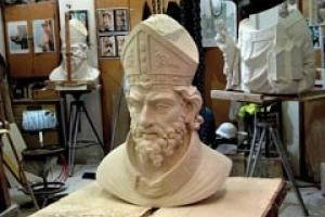 The head of St Peter in the carvers' workshop.