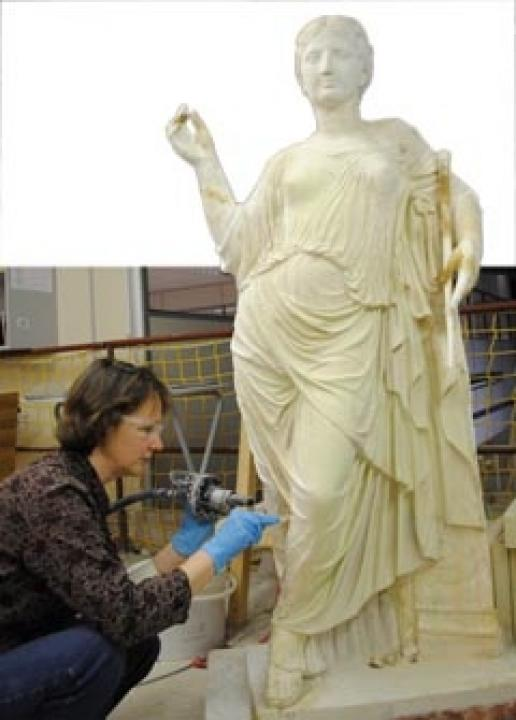 Alice Kingma working on the latest Bath sculpture being restored by Bath College students.