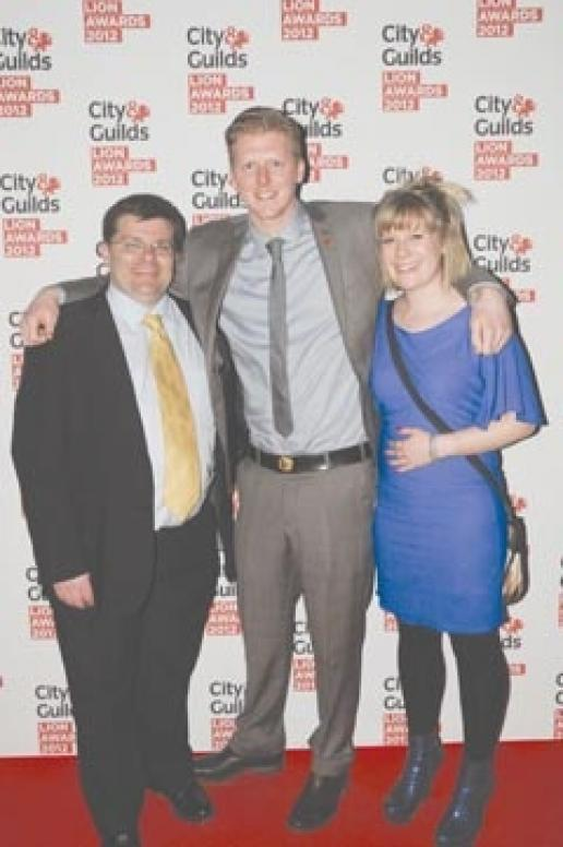 Sam Matthews at the City & Guilds Lion Awards between his girl friend, Sadie Jones, and Nigel Gilkison, the head of stonemasonry at the BCC.