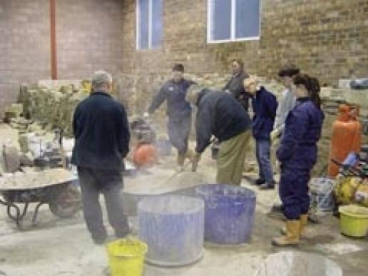 Slaking lime on a course at the Scottish Lime Centre.