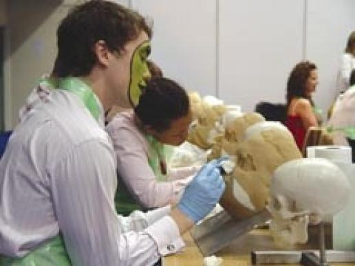 A mortician's holiday. An attraction at the show was lectures on reconstructing injured faces. It was one of the more macabre aspects of NFE.