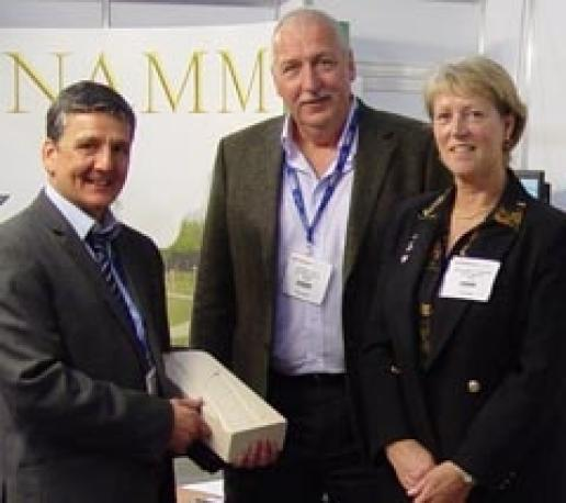 Phil Potts (centre) on the NAMM stand at the Natural Stone Show at ExCeL London last year: The merger of RQMF and BRAMM is extremely positive.