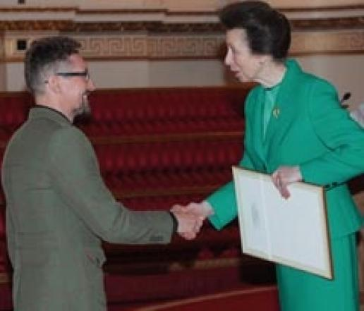 Dan Meek meets Princess Anne at Buckingham Palace.