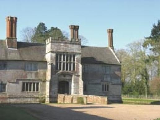 The manor house at Baddesley Clinton built of the grey sandstone from the Forest of Arden.